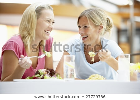 twee · vrouwen · coffeeshop · praten · vrouw · voedsel · bril - stockfoto © monkey_business