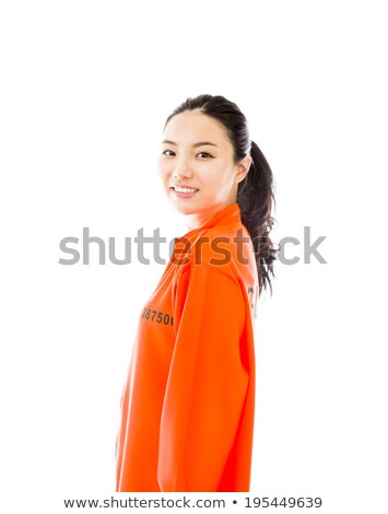 Young Asian woman smiling in prisoners uniform Stock photo © bmonteny