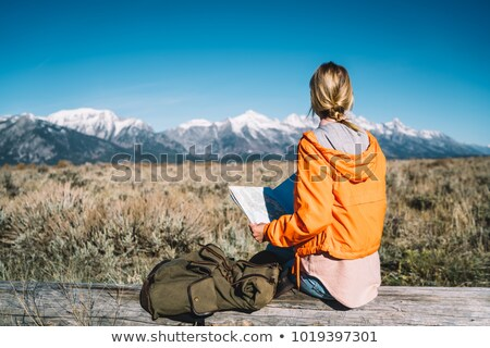 Tourist girl with rucksack and map Stock photo © Aleksangel