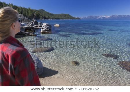 vrouw · kajakken · mooie · berg · meer · vreedzaam - stockfoto © feverpitch