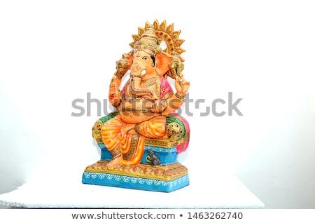 Red Indian statue on white background Stock photo © dekzer007