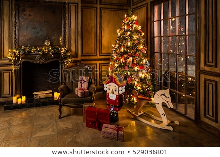 christmas tree with gifts and candles near fireplace stock photo © ankarb