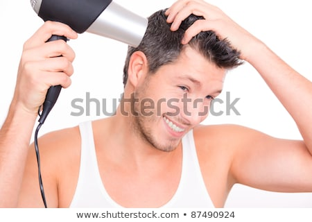 smiling male barber with hair dryer stock photo © feelphotoart