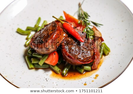 Stock fotó: Medallion With A Slice Of Tomato Sauce And Greens