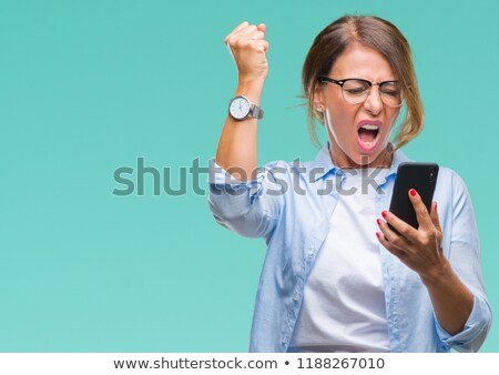 middle age, mad, frustrated angry woman yelling on mobile phone Stock photo © ichiosea