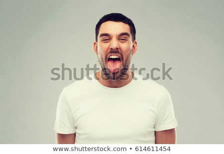 Man showing his tongue out Stock photo © stockyimages