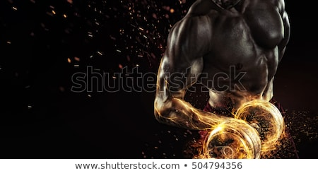 athletic guy bodybuilder , execute exercise with dumbbells Stock photo © restyler