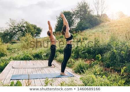 beautiful woman stretching hands stock photo © deandrobot