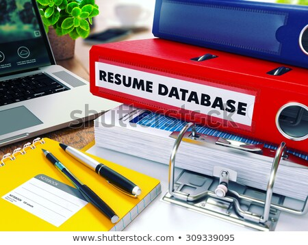 resume database on red ring binder blurred toned image stock photo © tashatuvango