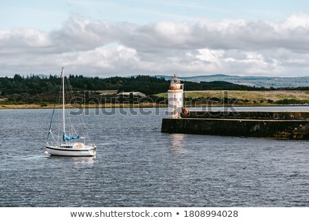 Small yacht sailing close to the shore Stock photo © epstock