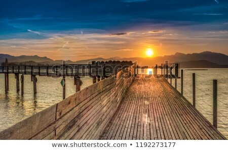 Sun rising at beach on bridge stock photo © jaffarali