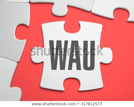 WAU - Puzzle on the Place of Missing Pieces. Stock photo © tashatuvango