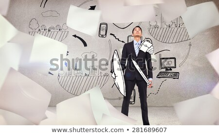 Medieval knight with sword and shield against gray wall Stock photo © igor_shmel