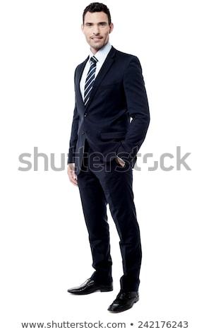 mosolyog · üzletember · kéz · a · kézben · zseb · dől · fehér - stock fotó © feedough