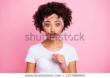 Játékos fiatal nő hamisítvány bajusz fotó fülke Stock fotó © Giulio_Fornasar