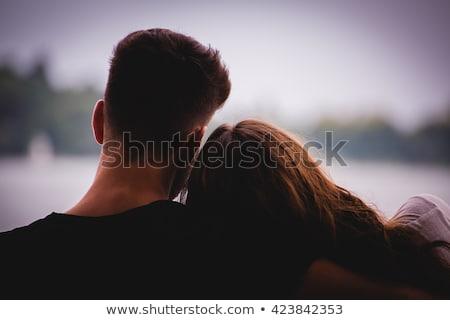 hátulnézet · mosolyog · vonzó · pár · szeretet · ül - stock fotó © deandrobot