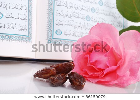 Holy Islam book, some dates and rose Stock photo © zurijeta
