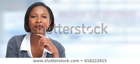 Black businesswoman smiling Stock photo © szefei