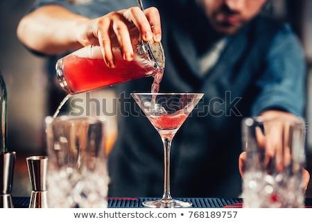 Close up shot of bartender garnishing fresh green cocktail with  Stock photo © Yatsenko