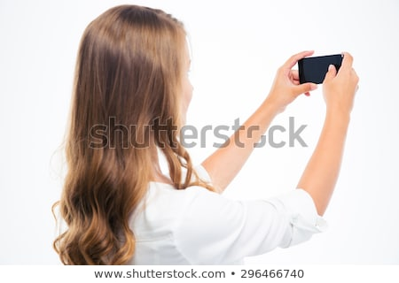 Back view of woman making photo Stock photo © deandrobot