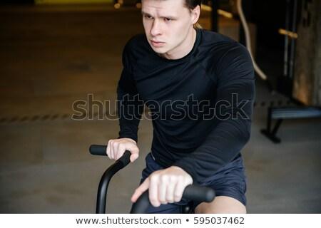 Muskuläre Mann Fahrrad Fitnessstudio Sport Stock foto © deandrobot