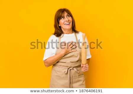 Young caucasian chef cook laughing out loud. Stock photo © RAStudio