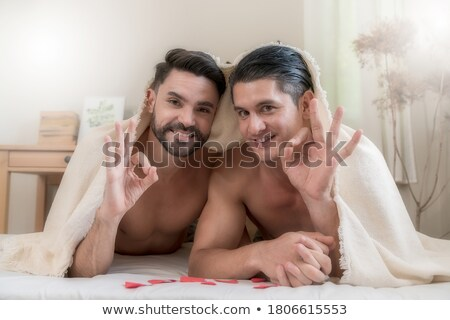 Gays in bed. Lovers men are in under  blanket. Love of LGBT Stock photo © MaryValery