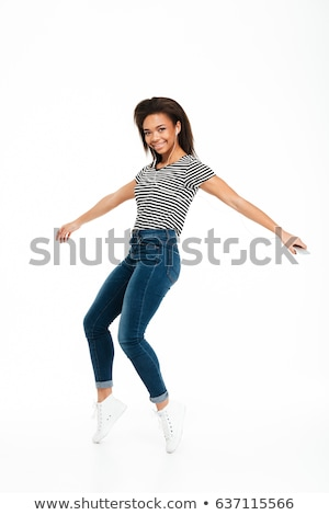 Young girl dancing over white background stock photo © julenochek