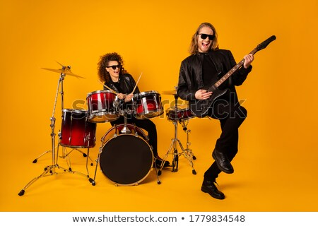 excited rock and roll couple playing electric guitar Stock photo © feedough