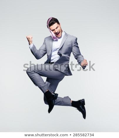 successful caucasian businessman jumping stock photo © rastudio