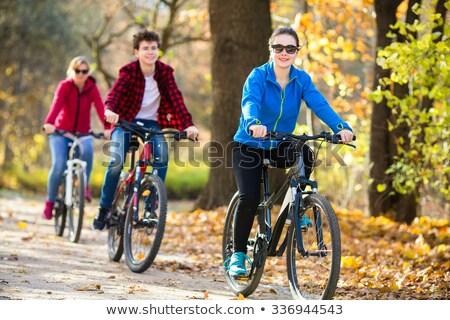 casal · equitação · bicicletas · homem · mulher - foto stock © is2