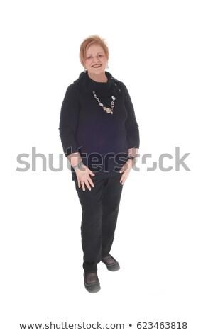 Stok fotoğraf: Bayan · siyah · elbise · çekici · bot · oturma