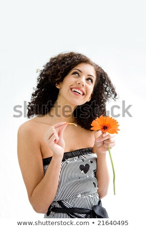 woman pulling petals from daisy Stock photo © IS2