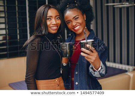 african american young businesswoman standing and drinking coffe stock photo © nikodzhi