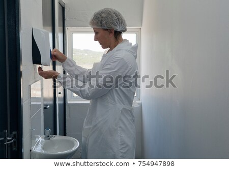 Factory worker using soap dispenser Stock photo © IS2