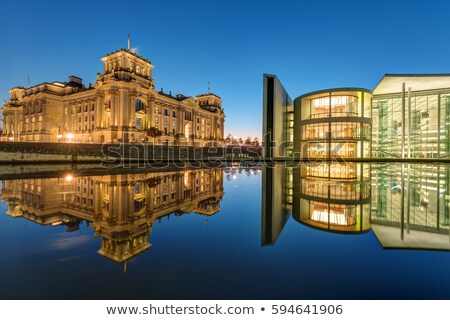 the famous reichtsag and the paul loebe haus at the river spree stock photo © elxeneize