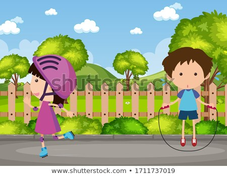 two boys playing jumprope in park stock photo © bluering
