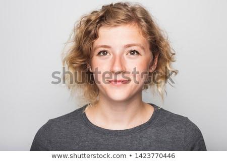 Auténtico primer plano retrato agradable femenino Foto stock © Anna_Om