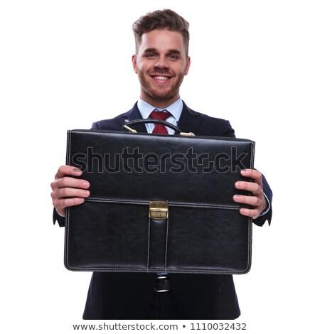 Ritratto sorridere imprenditore offrendo caso suit Foto d'archivio © feedough