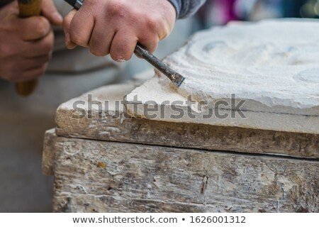Closeup shot of chisel and hammer in hands of a worker Stock photo © Nobilior