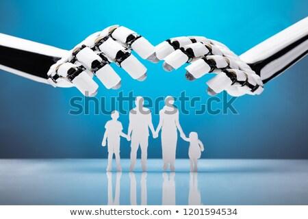 Robot Protecting Family Figures Stock photo © AndreyPopov