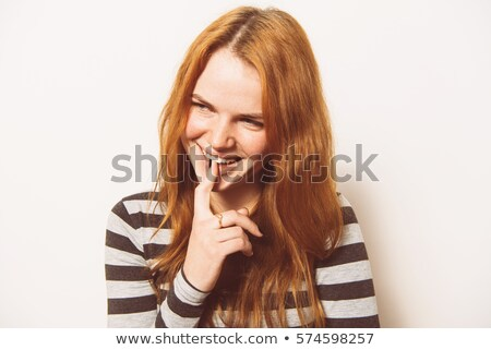 Woman putting finger in mouth Stock photo © Kzenon