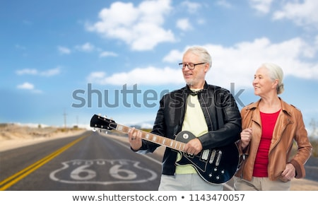 senior couple with electric guitar over route 66 Stock photo © dolgachov