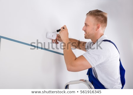 Electrician Installing Security System Motion Detector On Wall Stock photo © AndreyPopov