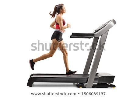Fitness vrouw lopen tredmolen vrouwelijke benen Stockfoto © Jasminko