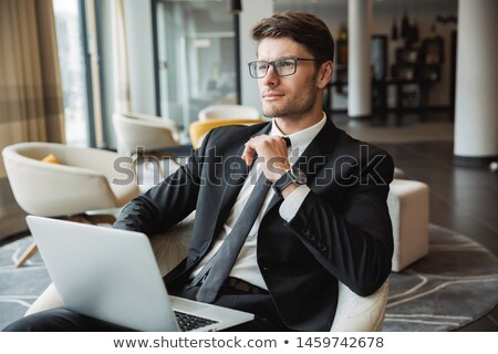 Portrait of concentrated caucasian man wearing businesslike suit Stock photo © deandrobot