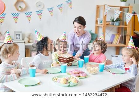 恍惚とした 若い女性 誕生日ケーキ 見える キャンドル ストックフォト © pressmaster