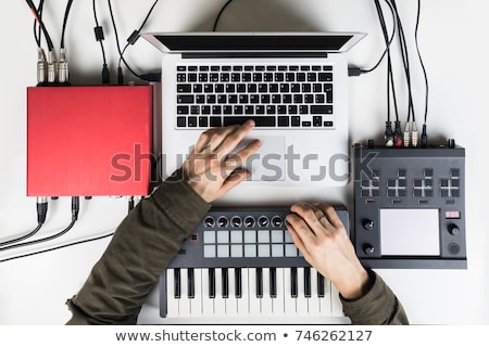 hand mixing music on midi controller stock photo © ra2studio