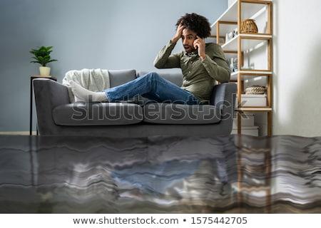 férfi · ül · kanapé · hív · vízvezetékszerelő · padló - stock fotó © andreypopov