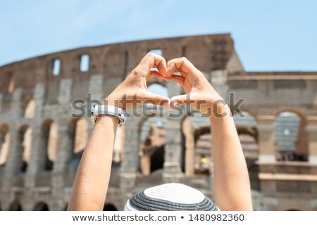 Woman Making Heart Shape In Front Of Colosseum Stock photo © AndreyPopov